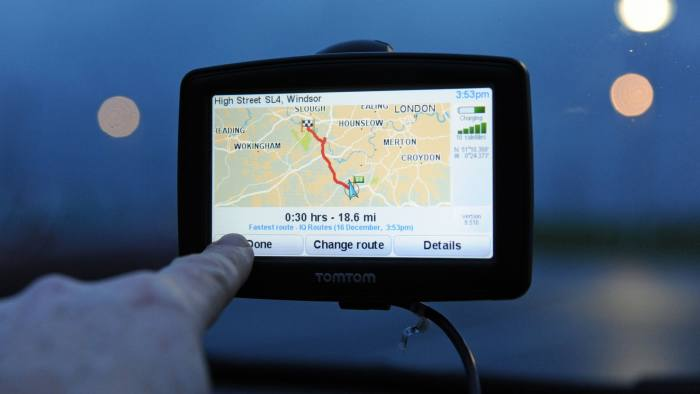 DMWCBY TomTom Sat nav being used in a car for navigation. Image shot 12/2013. Exact date unknown.