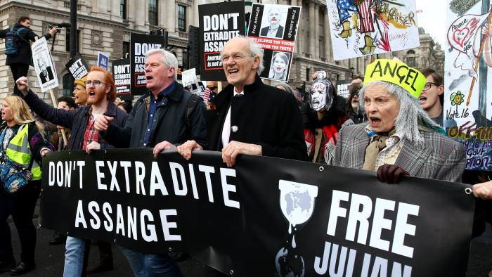 Supporters on Saturday march against the extradition of Julian Assange, including Wikileaks editor-in-chief Kristinn Hrafnsson, third from left, Julian Assange's father John Shipton, centre, and fashion designer Vivienne Westwood
