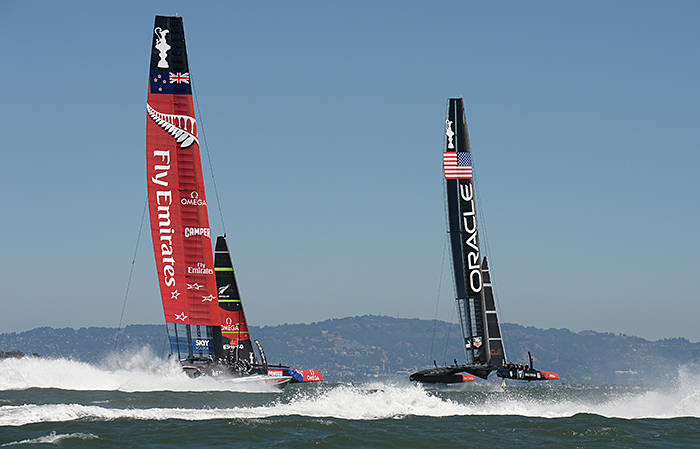 Emirates Team New Zealand (L) competes against Oracle Team USA during the 34th America's Cup on September 15, 2013 in San Francisco. AFP PHOTO/Don Emmert (Photo credit should read DON EMMERT/AFP via Getty Images)